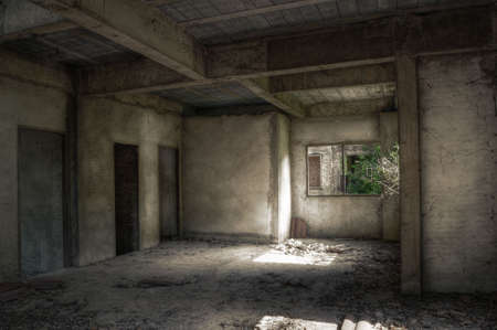 derelict: Interior of an empty dirty derelict house Stock Photo