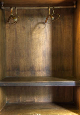 The inside of an empty wooden wardrobe photo