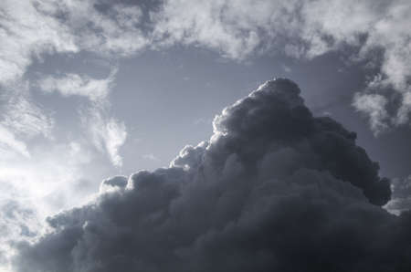 Cloudscape of a dark, pyramid shaped raincloud photo