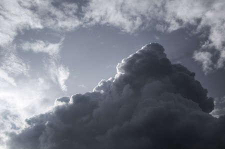 cloud drift: Cloudscape of a dark, pyramid shaped raincloud