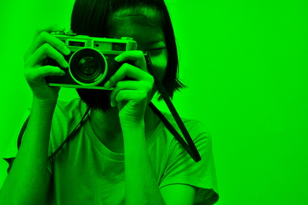 Illustration shows a girl using a vintage camera. Stock Photo
