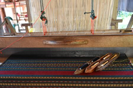 Fabric loom for weaving at home in northern part of Thailand. Standard-Bild