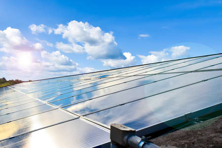 Photovoltaic system installed on the roof of the building, concept for using renewable and sustainable power from the sunligh.