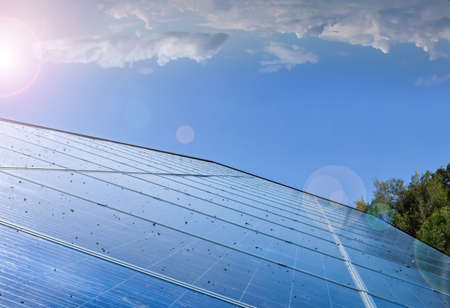 Photovoltaic system installed on the roof of the building, concept for using renewable and sustainable power from the sunligh. Archivio Fotografico