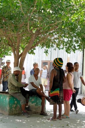 black rapper: Cubans speak on the Obispo street.  Havana, CUBA - August 2, 2015