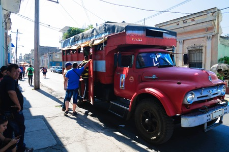 converted: Truck converted into a passenger bus. Buses of this type - the main form of transport in Cuba. CUBA CIENFUEGOS - 19 August 2015