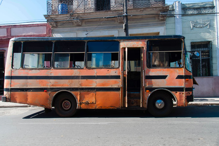tatty: IENFUEGOS, CUBA - 19 August 2015: Cuban public bus  parked in a street .