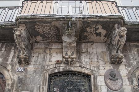 lvov: Balcony with sculpture in Lvov, Ukraine Stock Photo