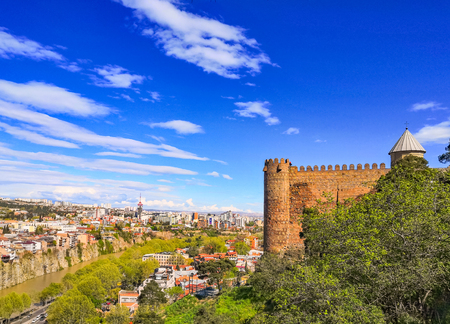Tbilisi, Georgia. Scenic View Of Impregnable Fortress Narikala And Church Of St. Nicholas. Blue clouded sky, Spring sunny day.