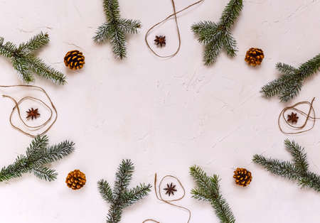 Christmas background, frame made of fir twigs, cones, berries. Christmas composition, decorated with pine tree branches, spices. Flat lay, top view, copy space.