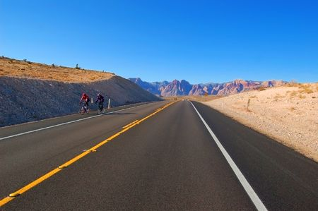 stuartkey: Cyclists in the mountains Stock Photo