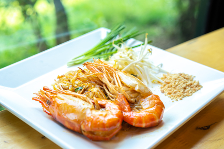 Thai fried noodles or Pad Thai with shrimp and vegetables.