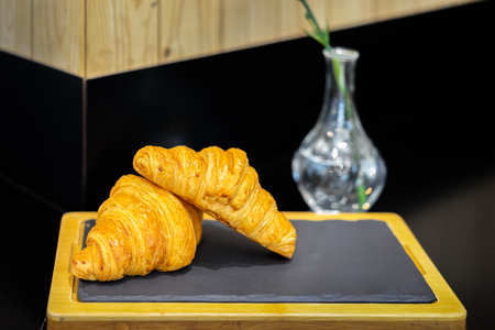 French croissants in a bakery shop. Crescent-shaped breads. Banco de Imagens