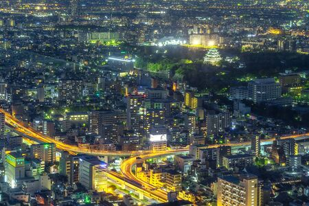 Nagoya, Japan - May 11, 2019: Cityscape background at night. The top of view on skyscraper. Banco de Imagens