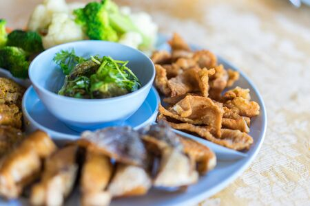 Northern Thai Green Chilli Dip (Nam Prik Num) served with streaky pork with crispy crackling and boiled vegetables.
