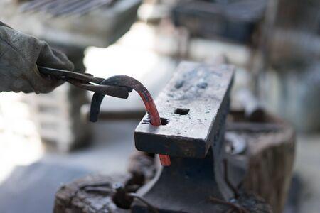 Blacksmith making a horseshoe from Lampang, Thailand.