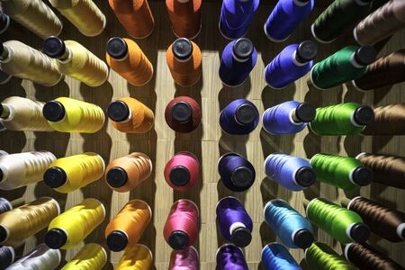 Sewing thread in the industry. Embroidery process for create patterns on textiles. Banco de Imagens - 132122896