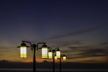 Vintage street lamps and sky in the twilight after sunset.