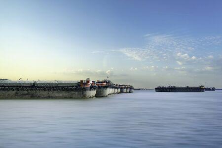 Cargo ship or freighter ship near the port of Chonburi, Thailand.