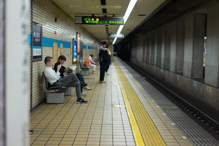 Nagoya, Japan - May 11, 2019: Nagoya, Japan - Passengers waiting for a subway train at Sengen-cho Station.