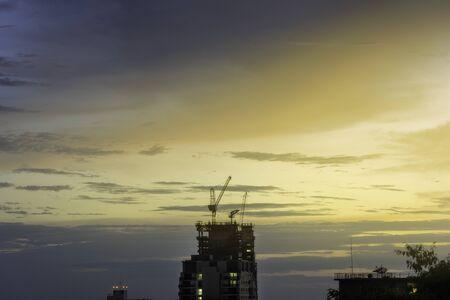 The Construction of the skyscraper, construction cranes in process. Banco de Imagens