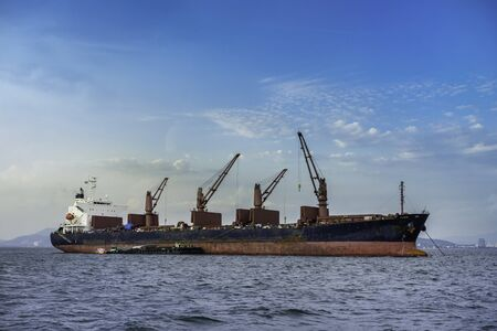 A cargo ship or freighter ship on sea in Thailand. International trade.