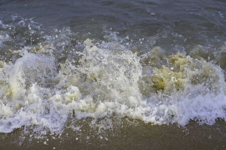 Beautiful nature landscape of sea wave on sandy beach. Background or wallpaper in holiday vacation.