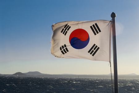 South Korea flag waving against clean blue sky Stock Photo