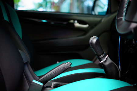 gearstick: Car interior with back seats tone sea green and black