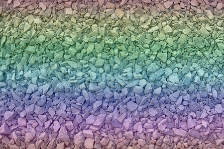 ballast: close up rainbow granite gravel background
