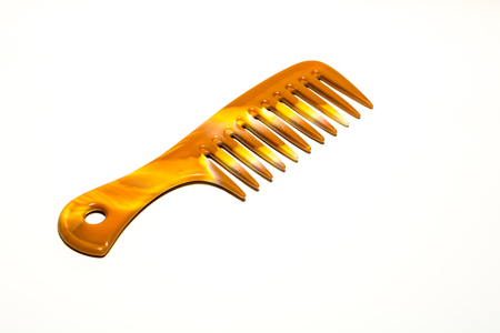 Comb is an accessories for styling hair on white background.