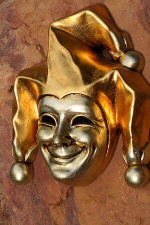 Golden Venetian mask of smiling joker Stock Photo - 957178