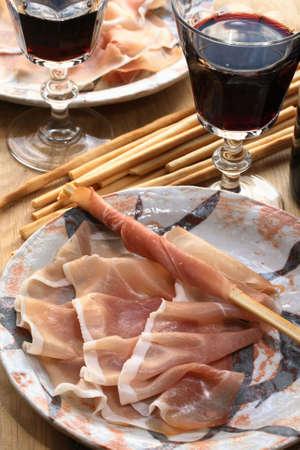 grissini: Prosciutto, grissini and red wine � delicious Italian snack.