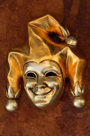 jester: Golden Venetian mask of smiling harlequin Stock Photo