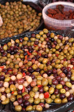 Olives,  pickled vegetables and sun dried tomatoes at the market in Provence   photo