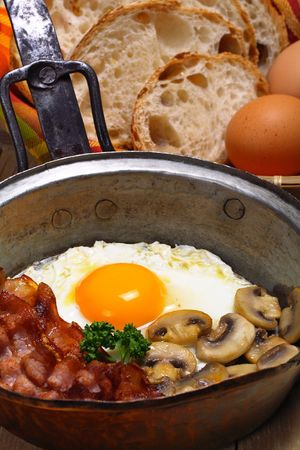 Fried egg, bacon and mushrooms with whole wheat bread, breakfast photo