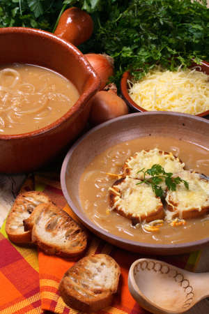 Classic French onion soup with croutons and cheese photo