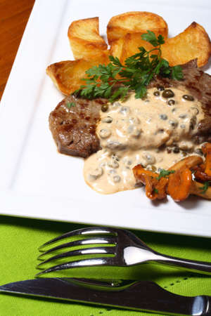 chanterelle: Grilled steak with chanterelle mushrooms and potatoes
