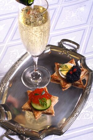 Champagne and canap�s with salmon roe and black caviar photo