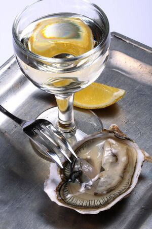 Oyster, a glass of white wine and lemon Stock Photo - 2064594
