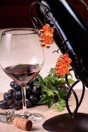wine testing: glass of wine, a wine bottle and a corkscrew