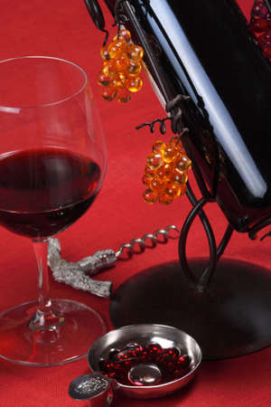 tastevin: Arrangement of a glass of wine, a taste-vin, a wine bottle and a vintage corkscrew