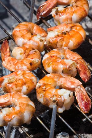 barbecued: Grilled prawns on the barbecue rack at the garden party Stock Photo