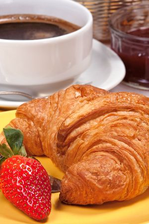 stimulation: Close-up of a croissant with coffee, jam and strawberries