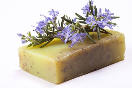 Handmade rosemary soap with the addition of essential oil and a branch of rosemary.