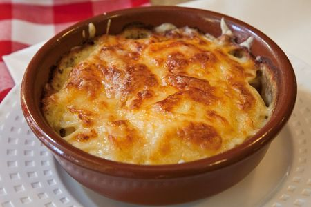 side dish: Gratin served as side dish at a French restaurant Stock Photo