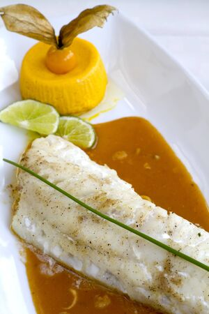 Fillet of fish with sauce lime and souffle photo
