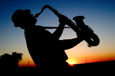 Saxophonist at sunset photo