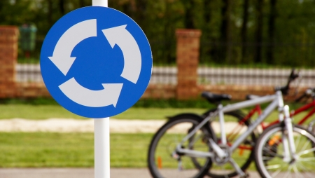 exceeded: A road sign with bicycles in the background