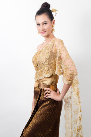 Woman wearing typical (traditional) Thai dress,vintage original Thailand attire ,identity culture of Thailand, in studio on white background